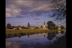 Canal and Church Steeple in Champvert